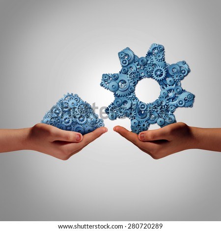 Technology management concept as a hand holding a group of mixed disorganized gears and cogs with another person presenting the machine parts put together as a symbol for a business manager.  - stock photo