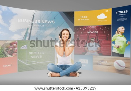 technology, music and happiness concept - smiling young woman or teen girl in headphones over virtual screens and web applications background - stock photo