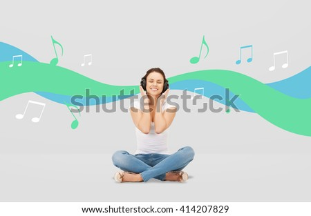 technology, music and happiness concept - smiling young woman or teen girl in headphones over gray background and musical wave with notes