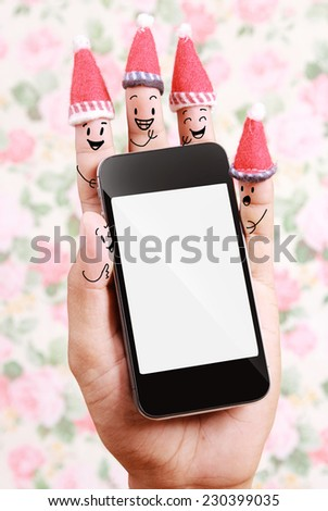technology of smart phone for Christmas background with human finger concept  - stock photo