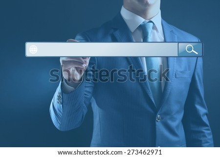 Technology, searching system and internet concept. Businessman hand pressing Search button - stock photo