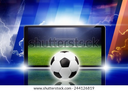 Technology, sports background - tablet pc and soccer ball, sports game online