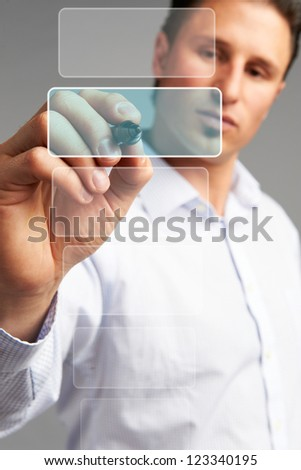 Technology touch concept: Business man pressing a touchscreen button - stock photo