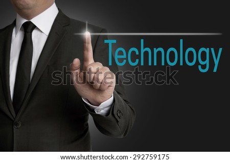 Technology touchscreen is operated by businessman. - stock photo