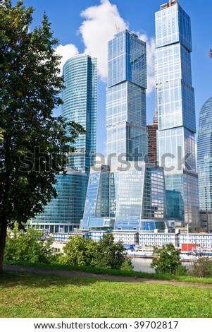 Technology versus nature, modern skyscrapers and green trees - stock photo