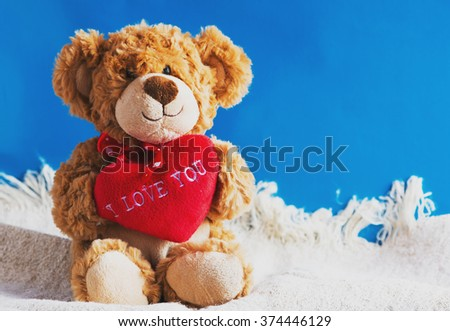 "Teddy bear and big red heart with text ""I Love You"""