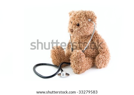 Teddy bear and stethoscope on a white background - stock photo