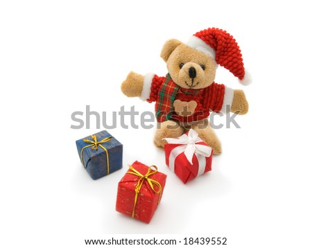 Teddy Bear and three colour gift boxes isolated on white background