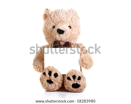 teddy bear holding a blank white piece of paper isolated on white - stock photo