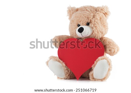 Teddy Bear Holding a Heart on white background - stock photo