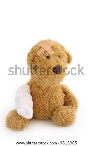 Teddy bear ill on white background - stock photo