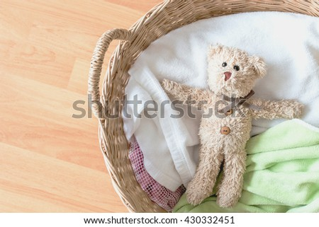 Teddy bear in basket - stock photo