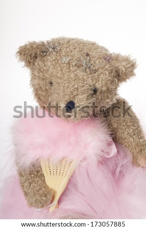 teddy bear knitting a long scarf isolated on white background