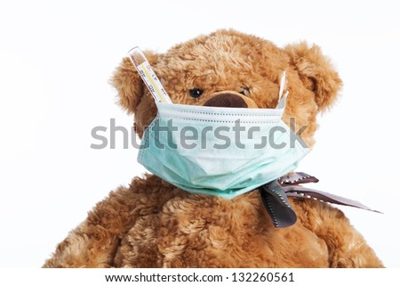 Teddy bear looking like a doctor (isolated on white) - stock photo