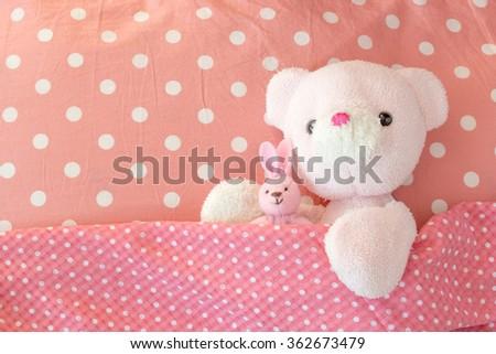 Teddy Bear lying in the bed / Teddy bear - stock photo