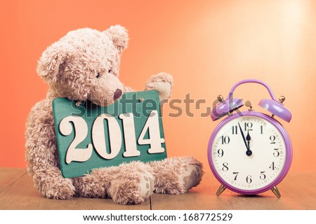 Teddy Bear, New Year date, retro clock for greeting card - stock photo