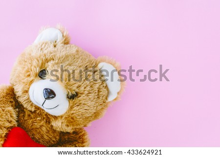 Teddy bear on pink background - stock photo