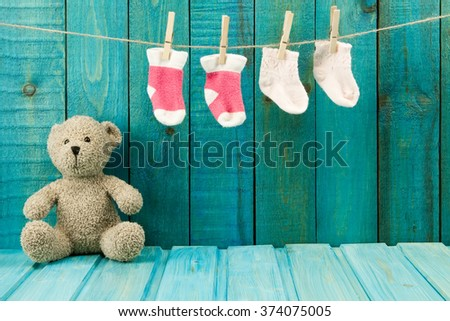 Teddy bear on turquoise wooden background. Baby toys - stock photo