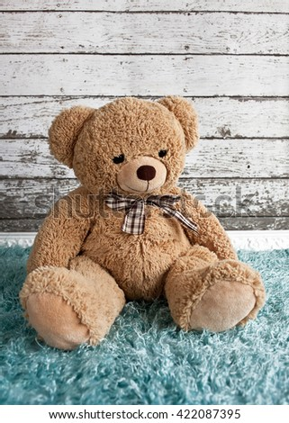 Teddy bear on wooden background - stock photo
