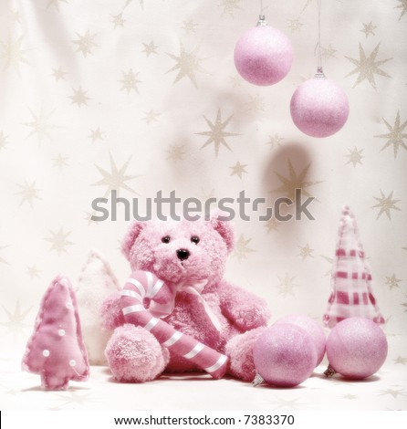 Teddy bear - pink teddy bear in winter theme - stock photo