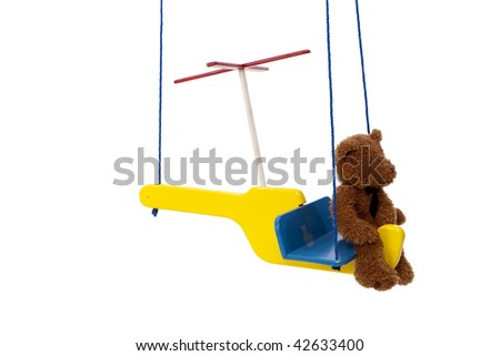 Teddy Bear Riding Helicopter Swing - stock photo