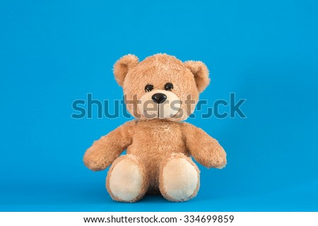 Teddy Bear toy alone with blue background - stock photo