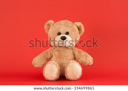 Teddy Bear toy alone with red background - stock photo