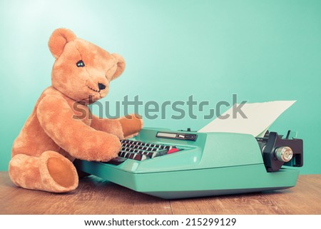Teddy Bear toy with retro mint green typewriter concept - stock photo