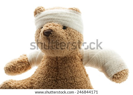 Teddy Bear with Bandage - stock photo