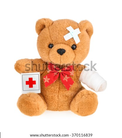 Teddy bear with bandage isolated on white - stock photo
