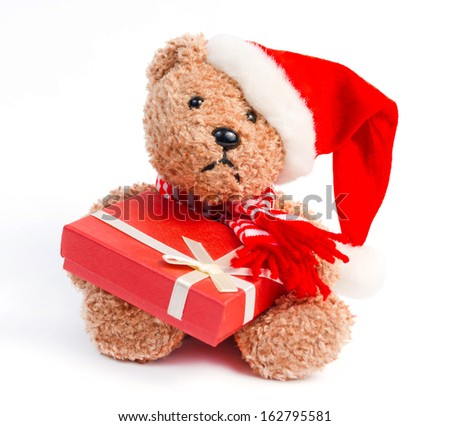 Teddy bear with Christmas gift isolated on white background
