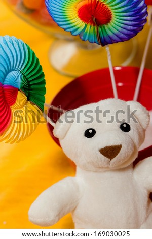 Teddy bear with colored paper toys - stock photo