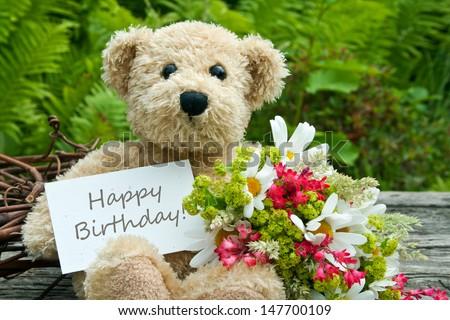 teddy bear with flowers and birthday card/birthday card/teddy - stock photo