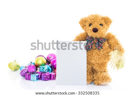 Teddy bear with gifts and blank greeting card on white background - stock photo