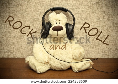 Teddy bear with headphones. Amateur rock and roll - stock photo