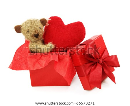 Teddy bear with heart in gift box isolated on white background