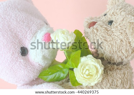 Teddy bear with jasmine flower - stock photo