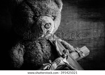 Teddy bear with jesus and the cross,Faith belief and hope concept