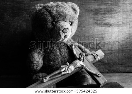 Teddy bear with jesus and the cross,Faith belief and hope concept,Black and white - stock photo