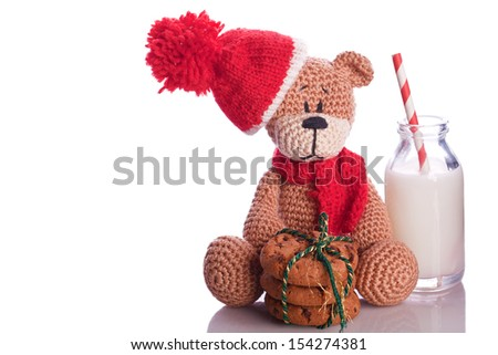 teddy bear with milk and cookies hat and scarf - stock photo