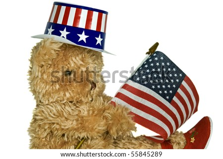 teddy bear with patriotic hat and flag