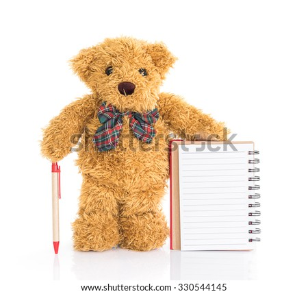 Teddy bear with pen and blank notebook on white background - stock photo