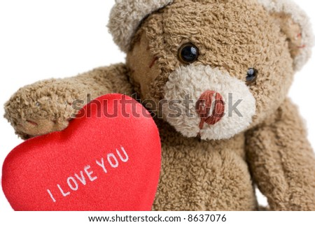 """Teddy bear with red heart - """"I love you"""" inscription on it. - stock photo"""