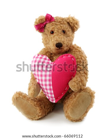 Teddy bear with red heart isolated on white background - stock photo