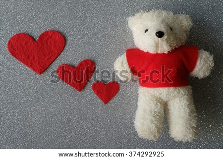 Teddy Bear with red Love hearts - stock photo