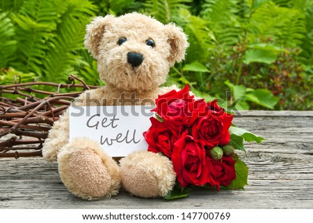 teddy bear with red roses  and card with lettering get well/get well/teddy