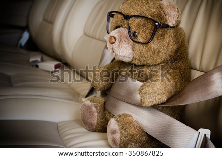 Teddy bear with safety belt,Safety concept - stock photo