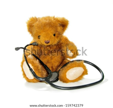 teddy bear with stethoscope - stock photo
