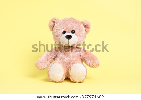 teddy bear with yellow background - stock photo