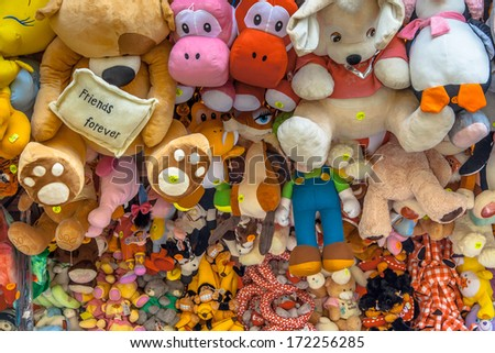 Teddy Bears and Cuddly Animal prizes in a Stall on a Fun Fair - stock photo